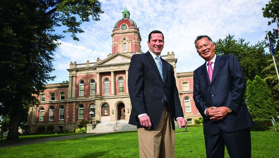 Pete McCown and Dzung Nguyen standing in front of the County Courthouse