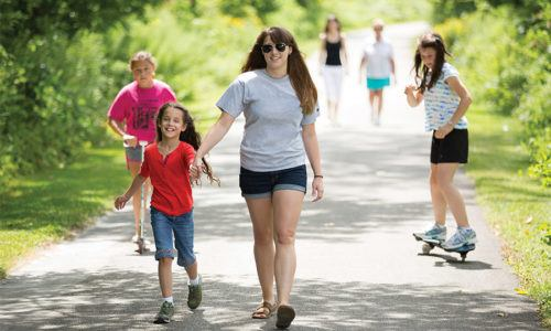 Young kids walking on the Pumpkinvine Trail