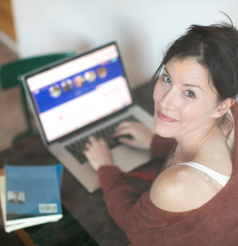 Woman on her laptop looking up